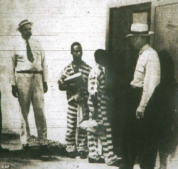 George Stinney, center right (with Bruce Hamilton, 21, center left) both enter the death house in the state prison in Columbia, where they were executed